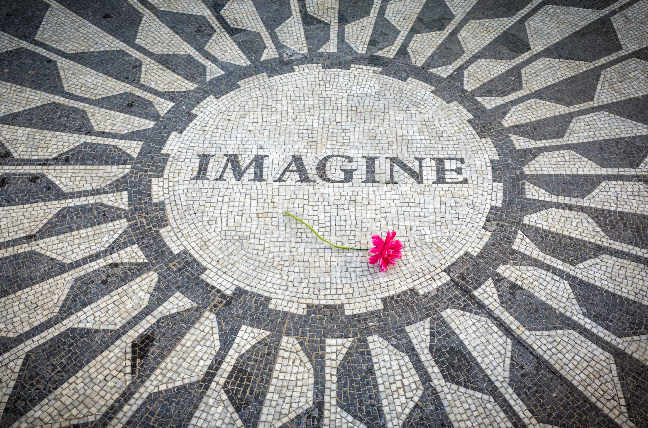 The stone mosaic bearing the title of Lennon's song: Imagine. Located in New York City's Central Park. Imagine solving unthinkable problems.